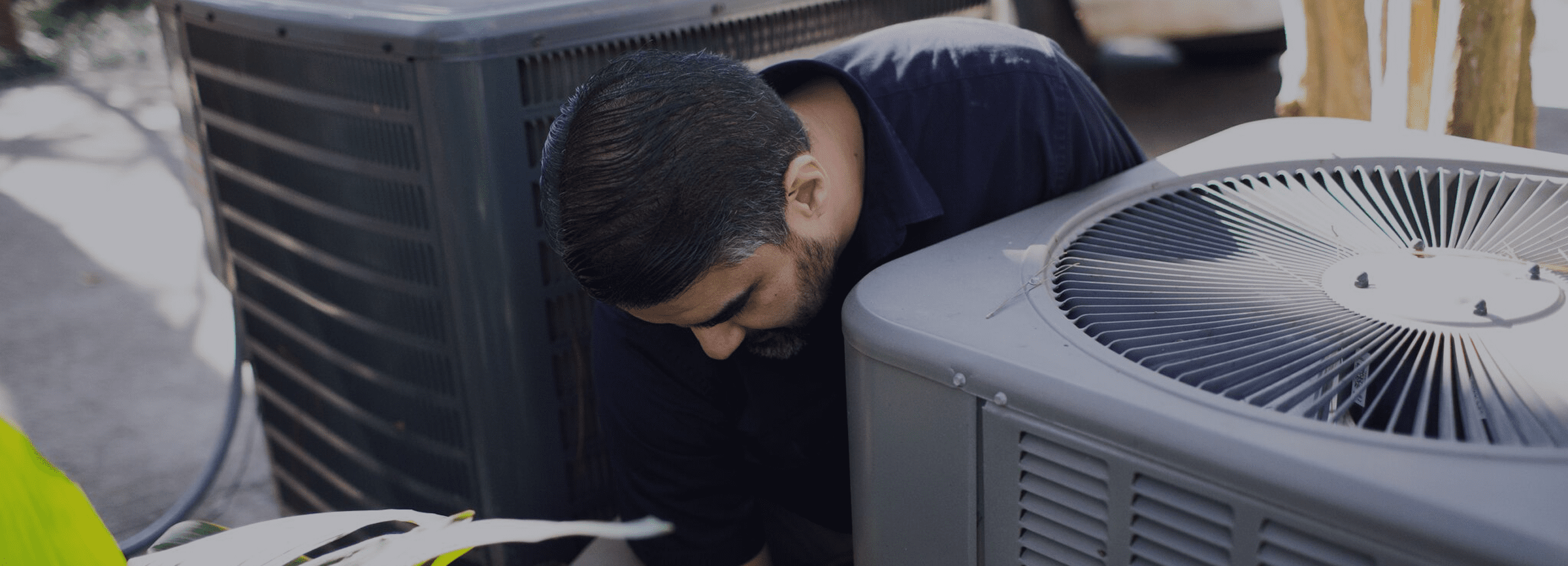 Technician working on air conditioning replacement