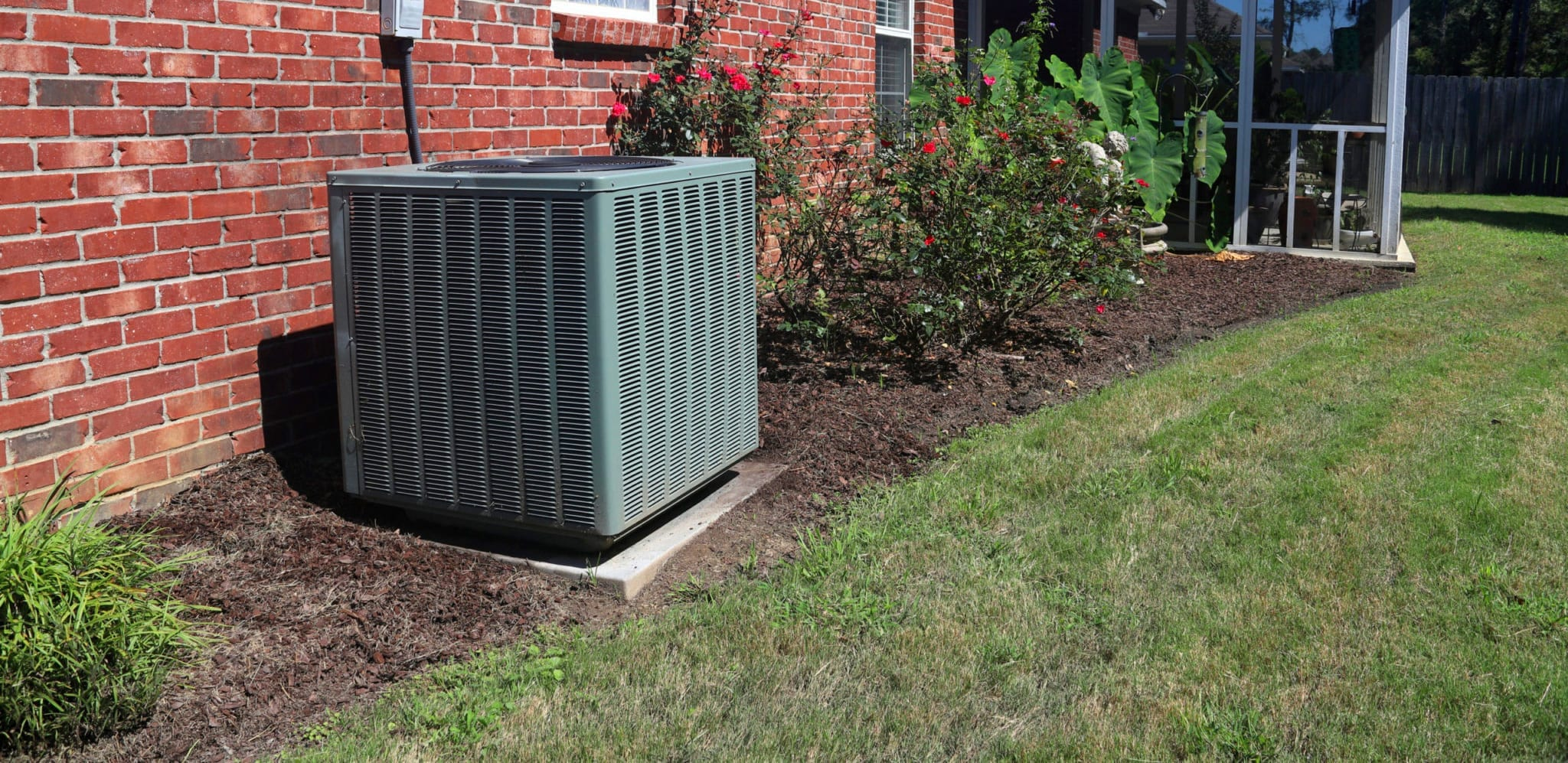 HVAC system condenser unit in the backyard