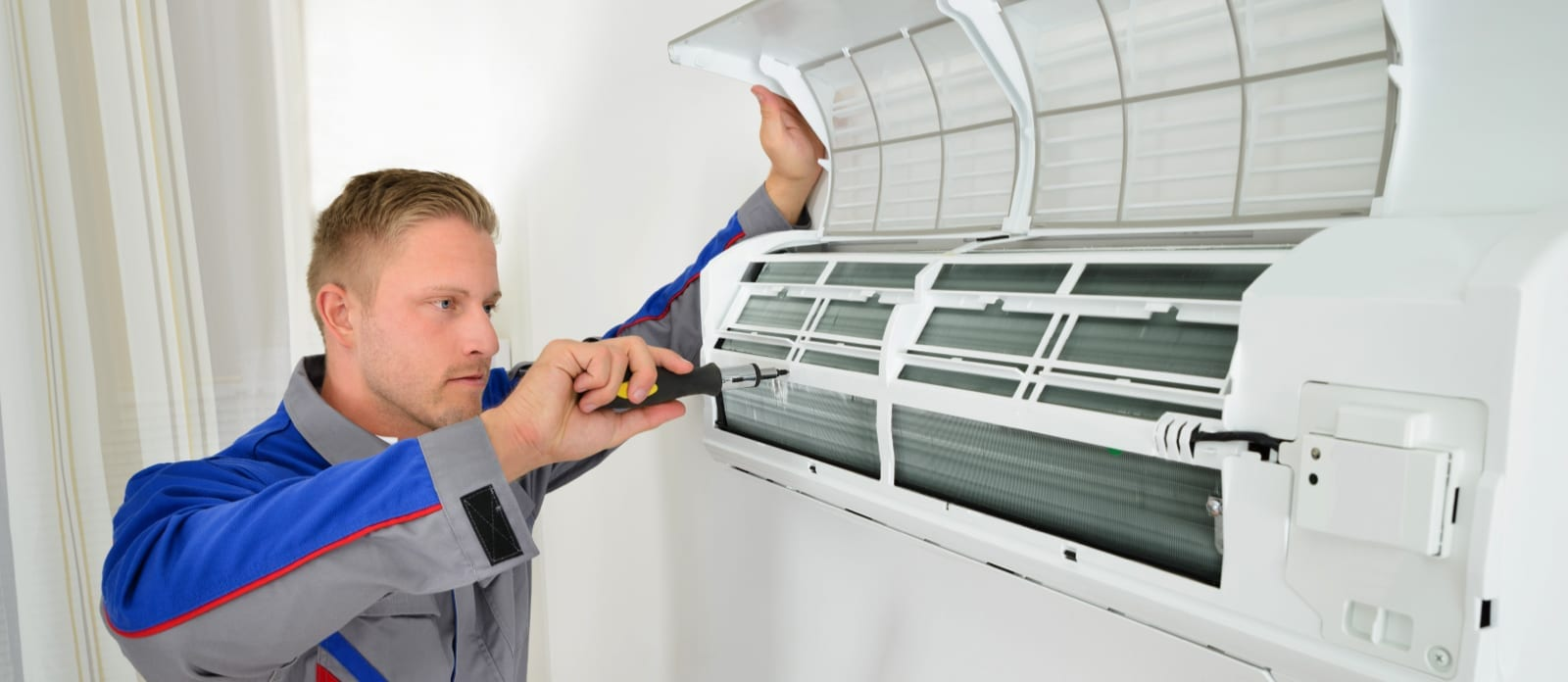 Man working on air conditioning repair and maintenance